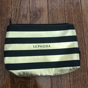 Sephora gold and black striped makeup bag